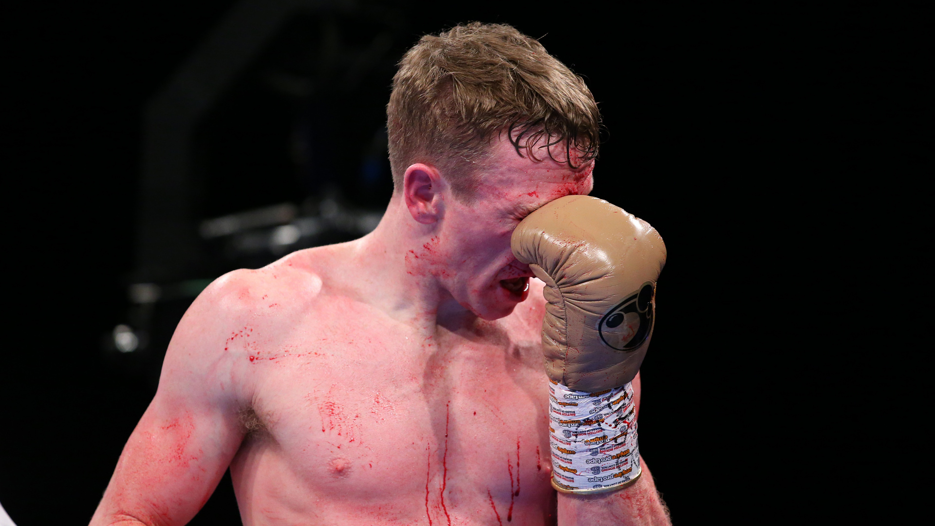 Tom Farrell reacts after an accidental clash of heads with Sean Dodd during their British Super-Lightweight Eliminator fight at M&S Bank Arena on November 23, 2019 in Liverpool, England.