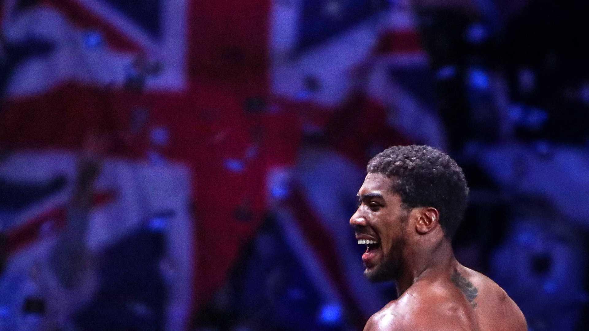 British boxer Anthony Joshua celebrates winning a bout against his American rival Andy Ruiz Jr and regaining his IBO, WBA Super, IBF and WBO World Heavy Titles at Diriyah Arena outside Riyadh