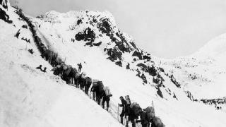 Gold-diggers in Alaska climbing up the Chilkoot pass on the way to Klondyke