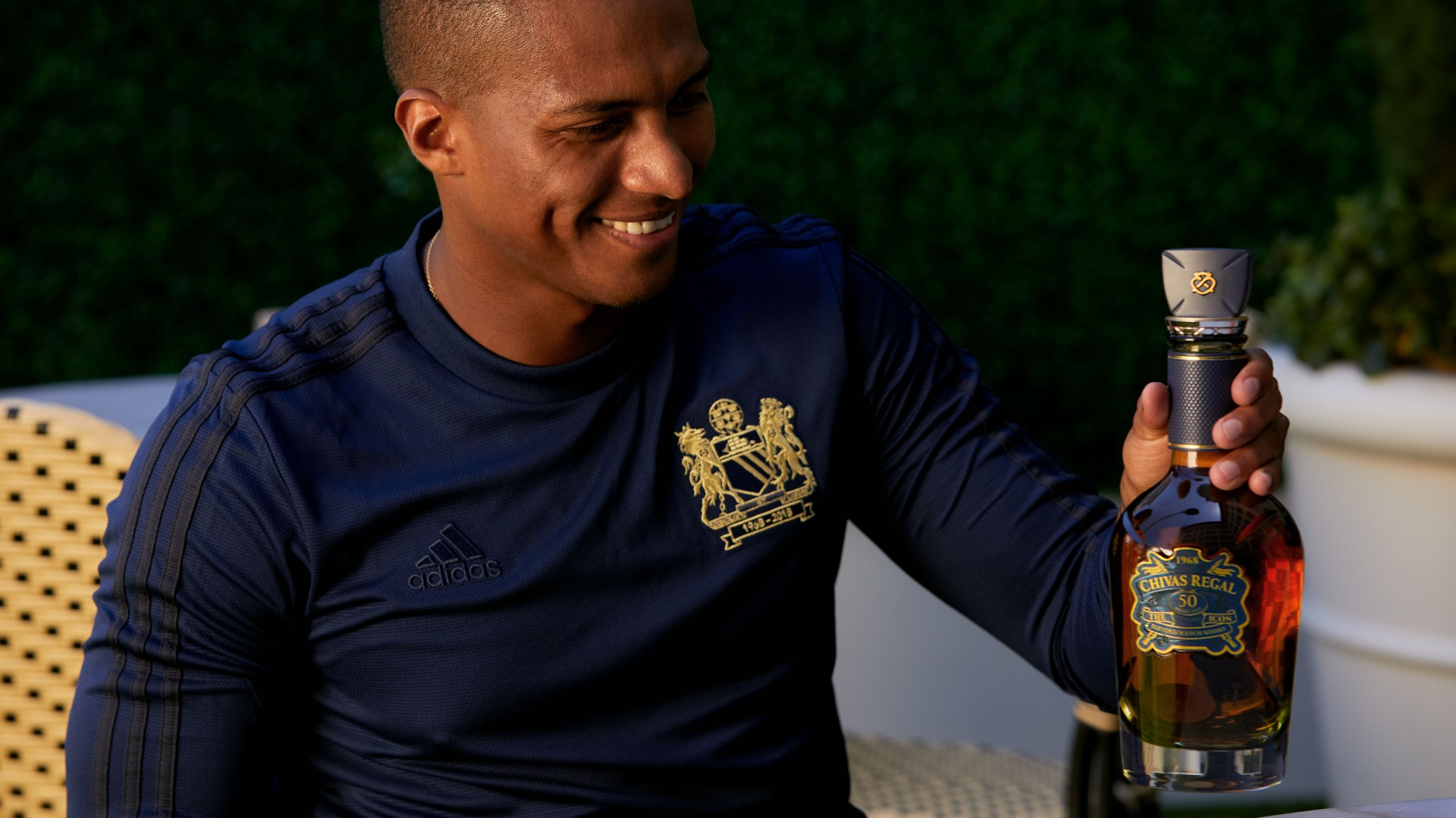3711014b5 Antonio Valencia contemplates which of his teammates he d most like to  smash over the head with this bottle of Chivas. It s heavy