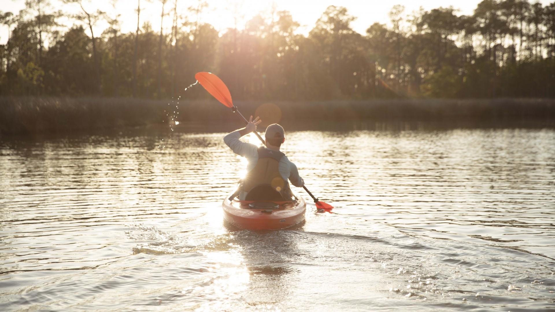 Man Kayaking in Alabama at Sunset