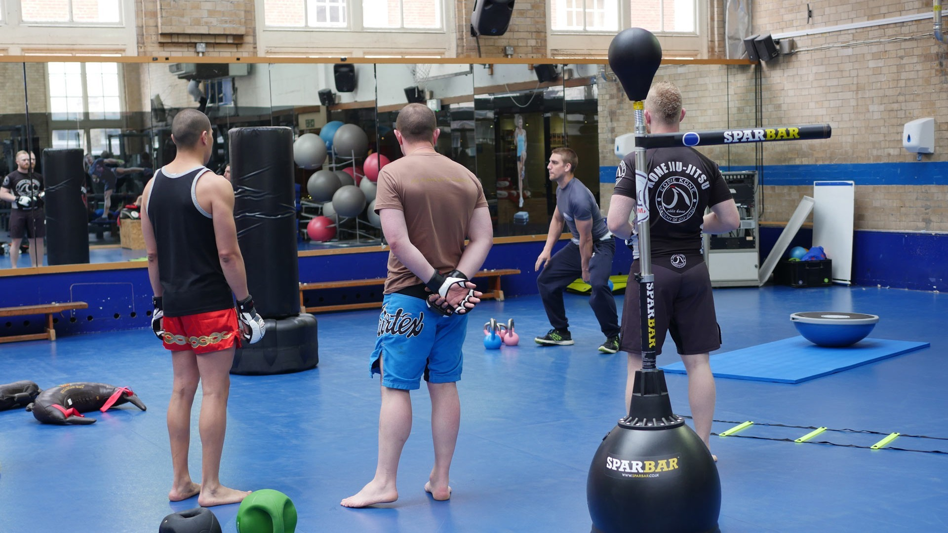 100% training MMA london interior shot with people