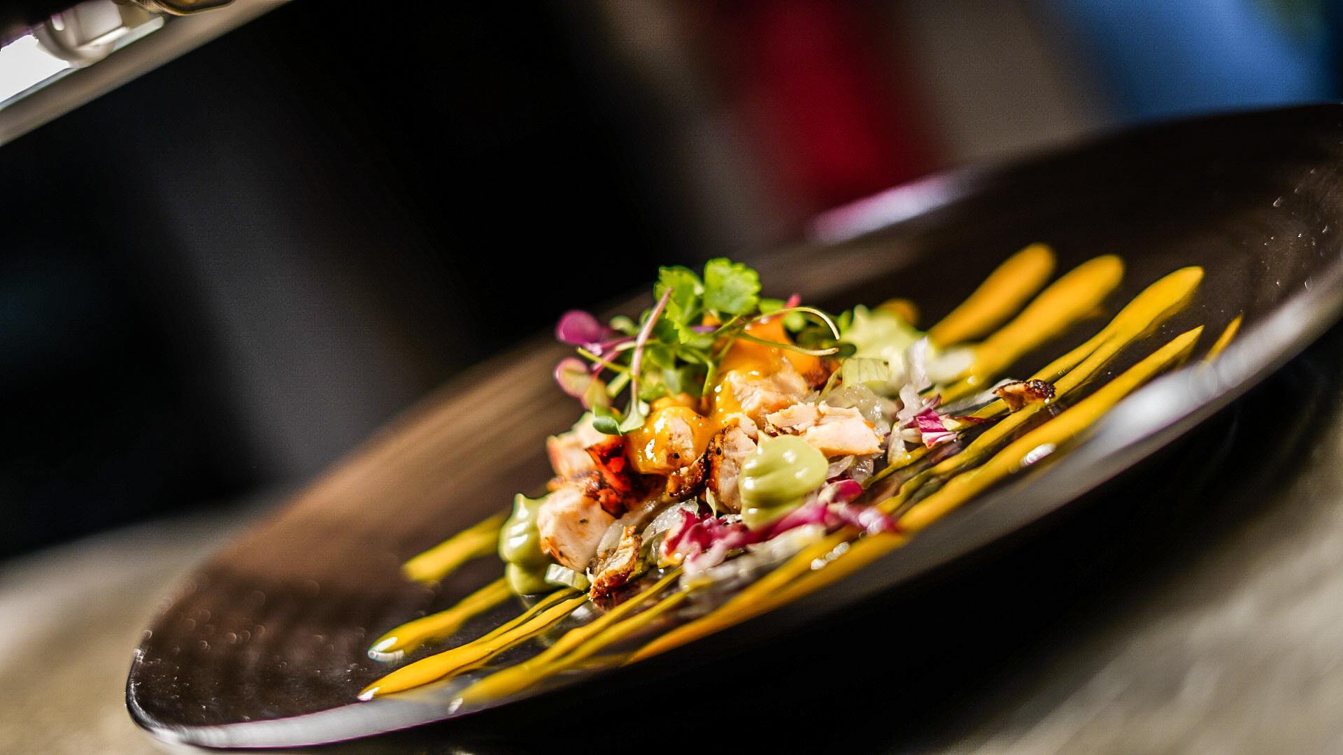 Grilled cornfed chicken with avocado purée, mix lettuce leaves and mango dressing