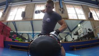 100% Gym MMA Training interior live shot with person working out