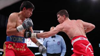 Luke Campbell in boxing match against Young action shot