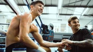 Luke Campbell in the gym with trainer