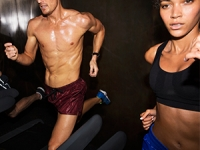 Man and woman running on the treadmill