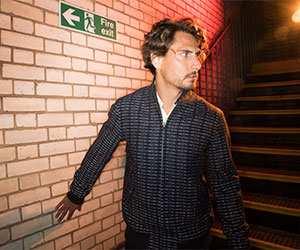 Man wearing reflective Dashing Harrington jacket by Fred Perry and Dashing Tweeds