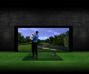 Man playing indoor golf simulator