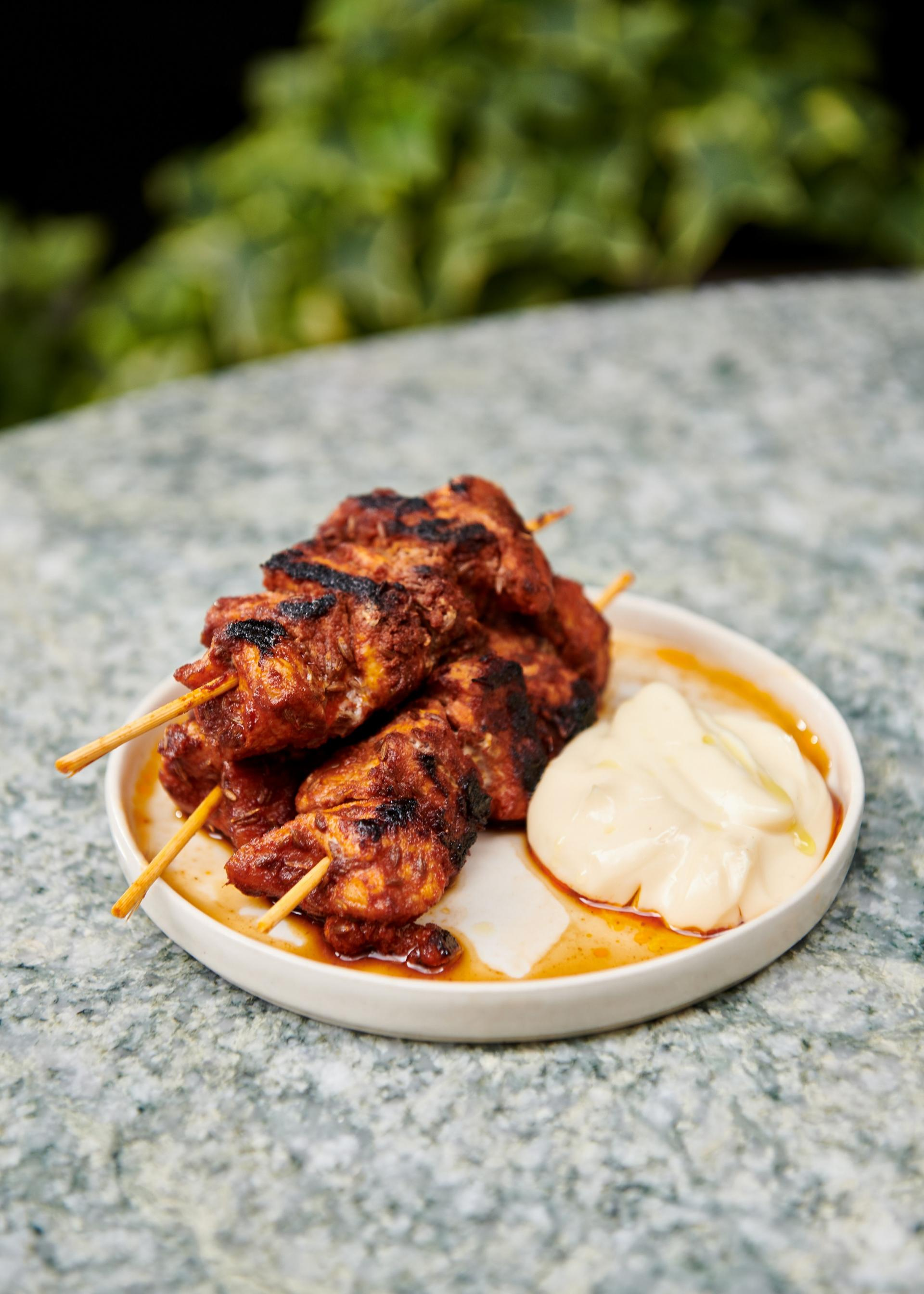 Grilled pork pinchos with almond alioli.