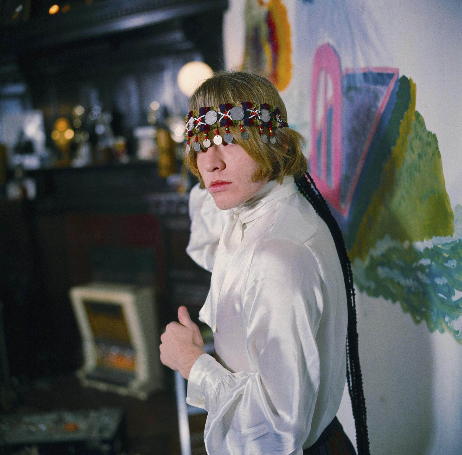 Brian Jones at home with North African headress in Courtfield Gardens, South Kensington