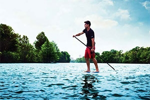 Man on a stand up paddle board